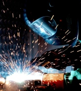 Man in mask welding