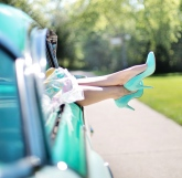 Fifties car with with high heeled shoes