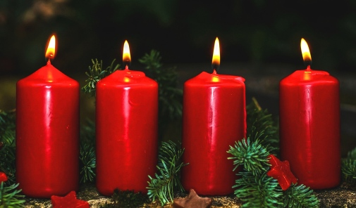 Four lit red advent candles